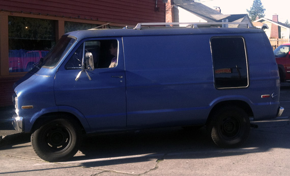A blue 1978 Dodge van.