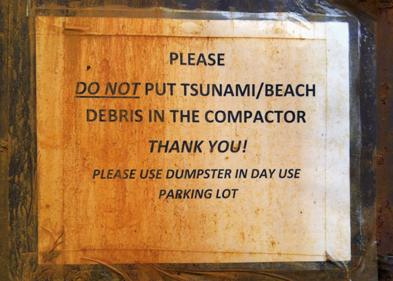 Tsunami debris sign at the Cape Lookout campground recycling area.