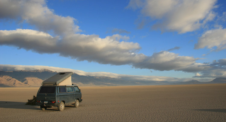 Blue VW Vanagon on a desert playa